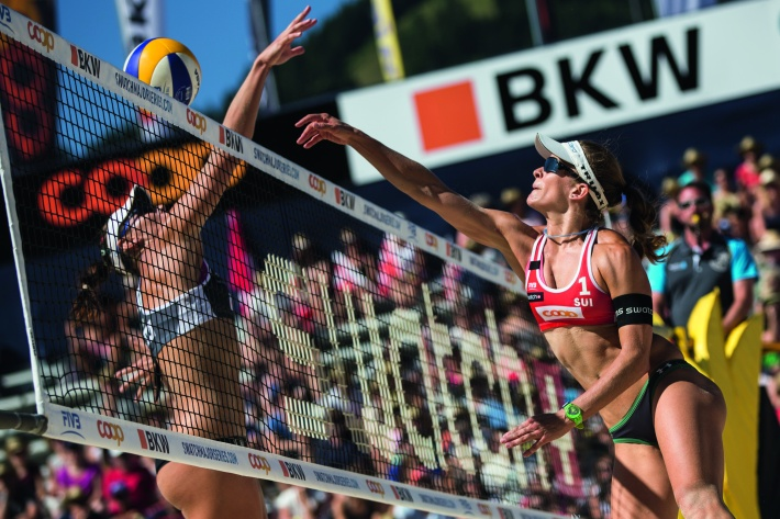 Liliana Fernandez Steiner, Elsa Baquerizo Macmillan of Spain and Nadine Zumkehr, Joana Heidrich of Switzerland compete during the Swatch Beach Volleyball Major Series in Gstaad, Switzerland on July 10, 2015